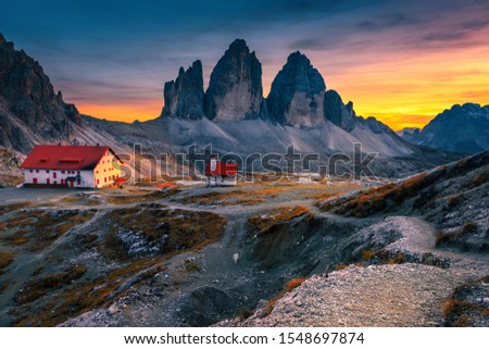 Picturesque Tre Cime di Lavaredo (Drei Zinnen) mountains with popular Rifugio Locatelli alpine hut and small chapel at colorful sunset, Dolomites, Italy, Europe Foto d'archivio ©