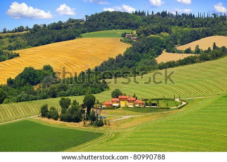Picturesque Tuscany landscape with house.