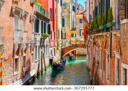 Stock Photo Picturesque view of Gondolas on lateral narrow Canal, Venice, Italy.