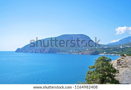 Picturesque view of sea bay surrounded with mountains & rocks. Ayu-Dag, Crimea. Selective focus