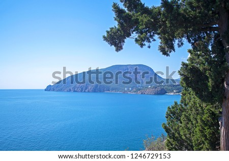 Picturesque view of sea bay surrounded with mountains & rocks. Ayu-Dag, famous mountain, symbol of Crimea. Selective focus