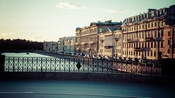 Picturesque view on Fontanka river (part of Neva river) in Saint Petersburg in summer during white nights. Toned picture.