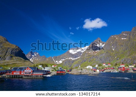 Picturesque village on Lofoten islands in Norway surrounded by scenic mountains