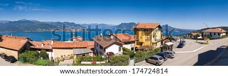 Picturesque villas gazing over the beautiful lake Maggiore in the Italian Lake District.