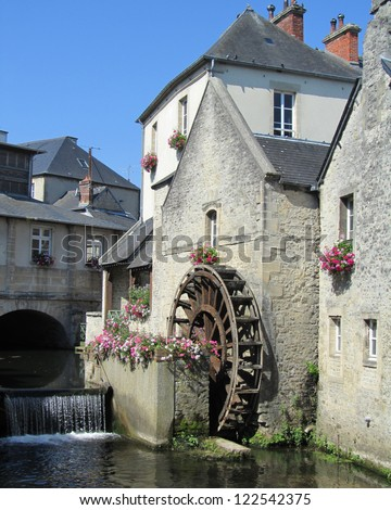 Picturesque Waterwheel, Bayeux: A waterwheel on the river Aure in the historic center of Bayeux, Normandy,  France.