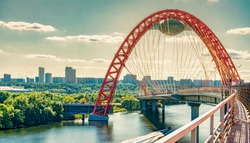 Picturesque (Zhivopisny) bridge over the Moscow river on sunset. The picturesque bridge is a cable-stayed bridge over the Moscow river, the highest bridge of this type in Europe.
