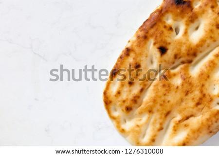 Pide Bread Pita or Ramazan Pidesi isa traditional Turkish Bread #1276310008