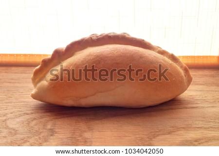 Pie baked close-up blurred orange background #1034042050