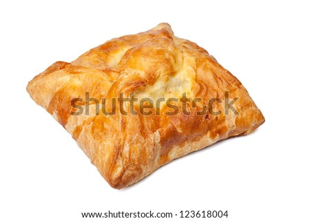 pie from flaky pastry on a white background
