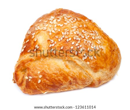 pie from flaky pastry strewed with sesame seeds on a white background