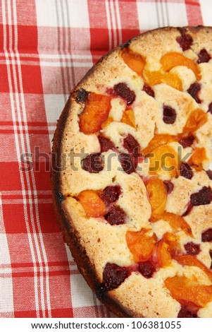 Pie with apricots and raspberry