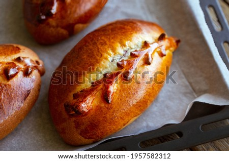 Pie with fruit.Apple Pie.Traditional Russian Baked Pies.Pies. Russian homemade bun with berries.Cherry Pie.Close-up of pastries from the oven on a pan.Baking on a pan.Pirozhki with Cherry. summer
