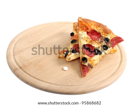 piece of an appetizing delightful pizza and white tablet, medicine lie on a wooden plate