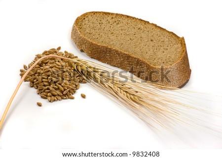 Piece of bread, grain and wheat ear