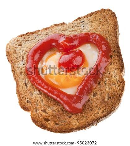 piece of bread toast cut in shape of heart with egg and tomato ketchup Isolated on white background