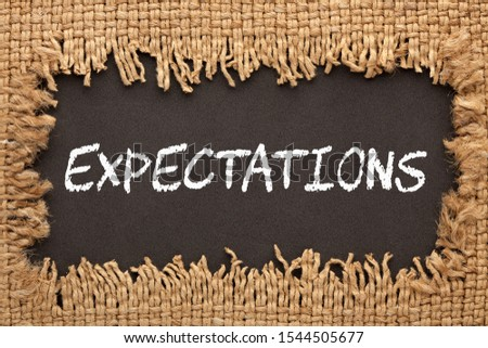 Piece of burlap with hole with the word Expectations. Business concept