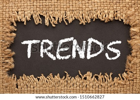 Piece of burlap with hole with the word Trends. Business concept.