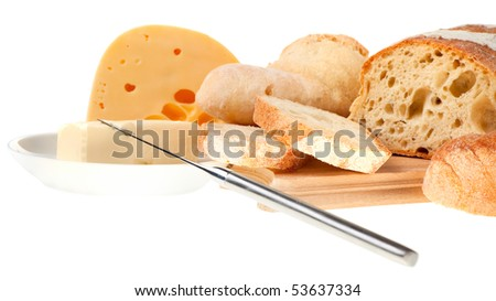 piece of butter, cheese, bread and a knife