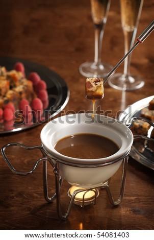 piece of cake dipped into a chocolate fondue