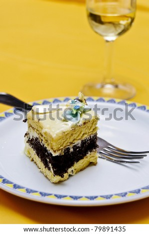 Piece of cake that looks delicious with great colors with glass of wine