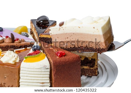 Piece of cake three-layered souffl���©.  Isolated on white background.
