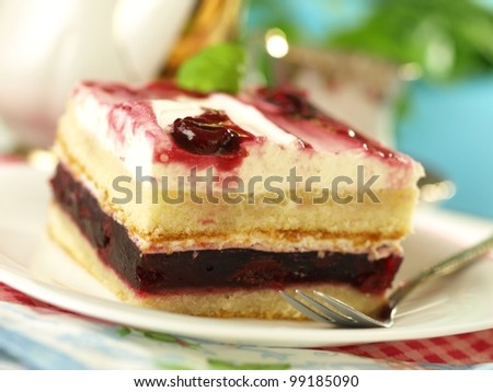 Piece of cake with cherries and whipped cream - stock photo