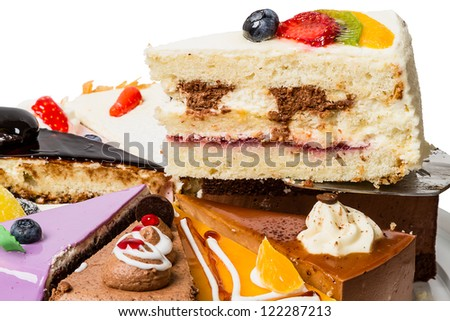 Piece of cake with fruit. Side view close-up
