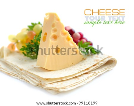 Piece of cheese with greenery on a pita - stock photo