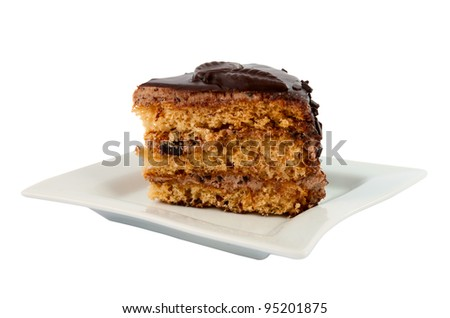 piece of chocolate cake on a plate isolated on white background