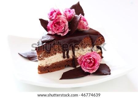 piece of chocolate cake on white isolated background