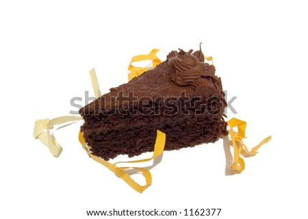 Piece of Chocolate Cake surrounded by yellow and orange festive paper ribbons.