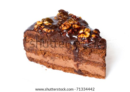 Piece of chocolate cake with walnuts. Isolated on white background.