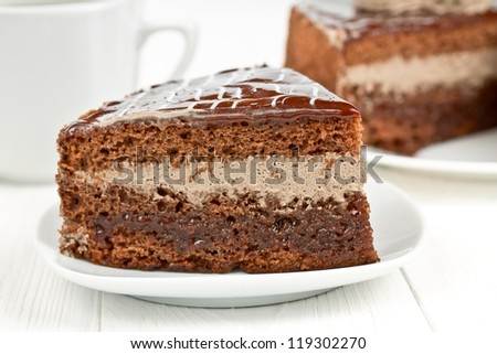 piece of chocolate cake with whipped cream - stock photo