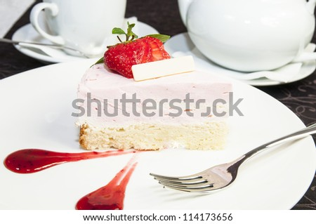piece of cream cake on a white plate in a restaurant