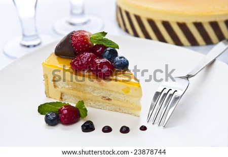 piece of delicious cake with a fork and glasses