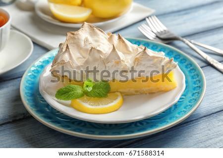 Piece of delicious lemon meringue pie on plate