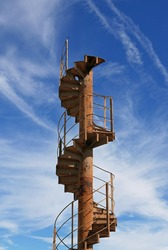 Piece of Eiffel Tower spiral staircase ending in the sky