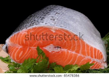 Piece of fatty red fresh trout. Food background