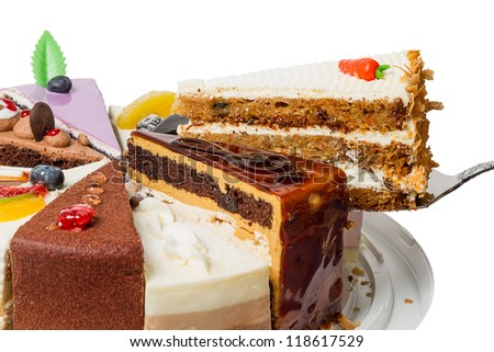 Piece of layer cake with nuts. Side view close-up