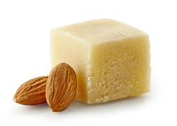 piece of marzipan and almonds isolated on white background, selective focus