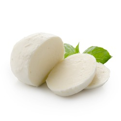 Piece of mozzarella Buffalo isolated on white background with clipping path. Decorated with basil. Front view.