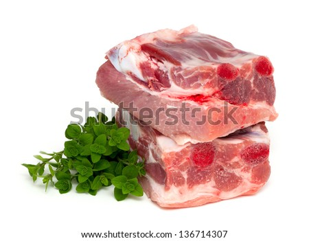 piece of pork ribs and marjoram herb isolated on white background
