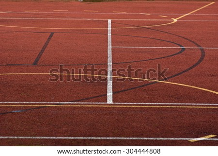Piece of red basketball field
