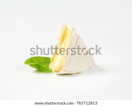 piece of soft-ripened cheese with white rind