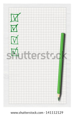 piece of squared paper with completed checklist over white background