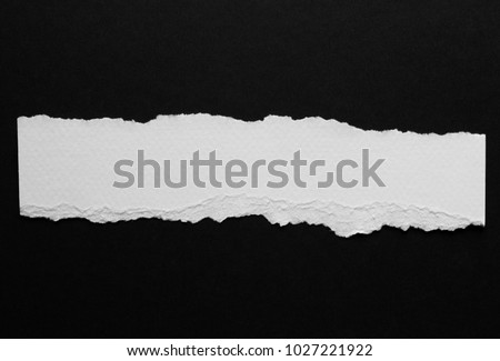 piece of torn paper isolated on black Foto stock ©