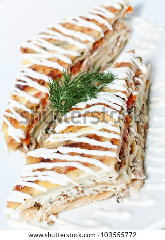 Piece of vegetable pie with meat.