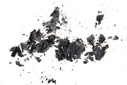 Pieces of burnt paper on a white background. The ashes of the paper. Charred paper scraps.