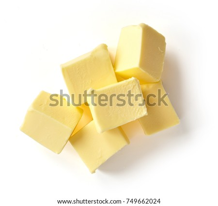 Pieces of butter isolated on white background, top view