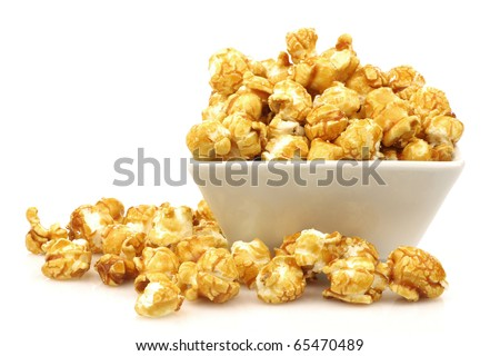 pieces of caramel  popcorn in a  bowl on a white background - stock photo